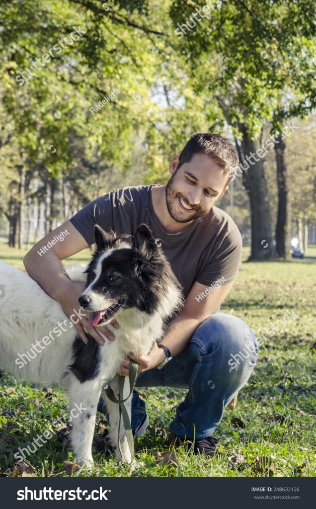 stock-photo-man-and-his-dog-playing-in-the-park-248632126